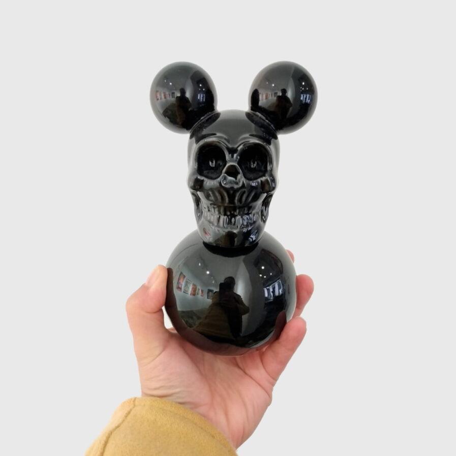 holding a sculpture