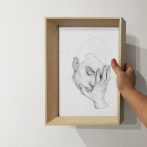 holding piece of art